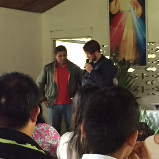 Andrew McGurl and Felix speaking to the congregation